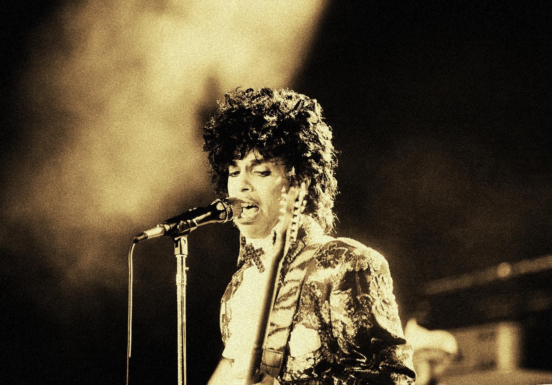 Rock singer Prince performs at the Orange Bowl during his Purple Rain tour in Miami, Fla., April 7, 1985.  (AP Photo/Phil Sandlin)